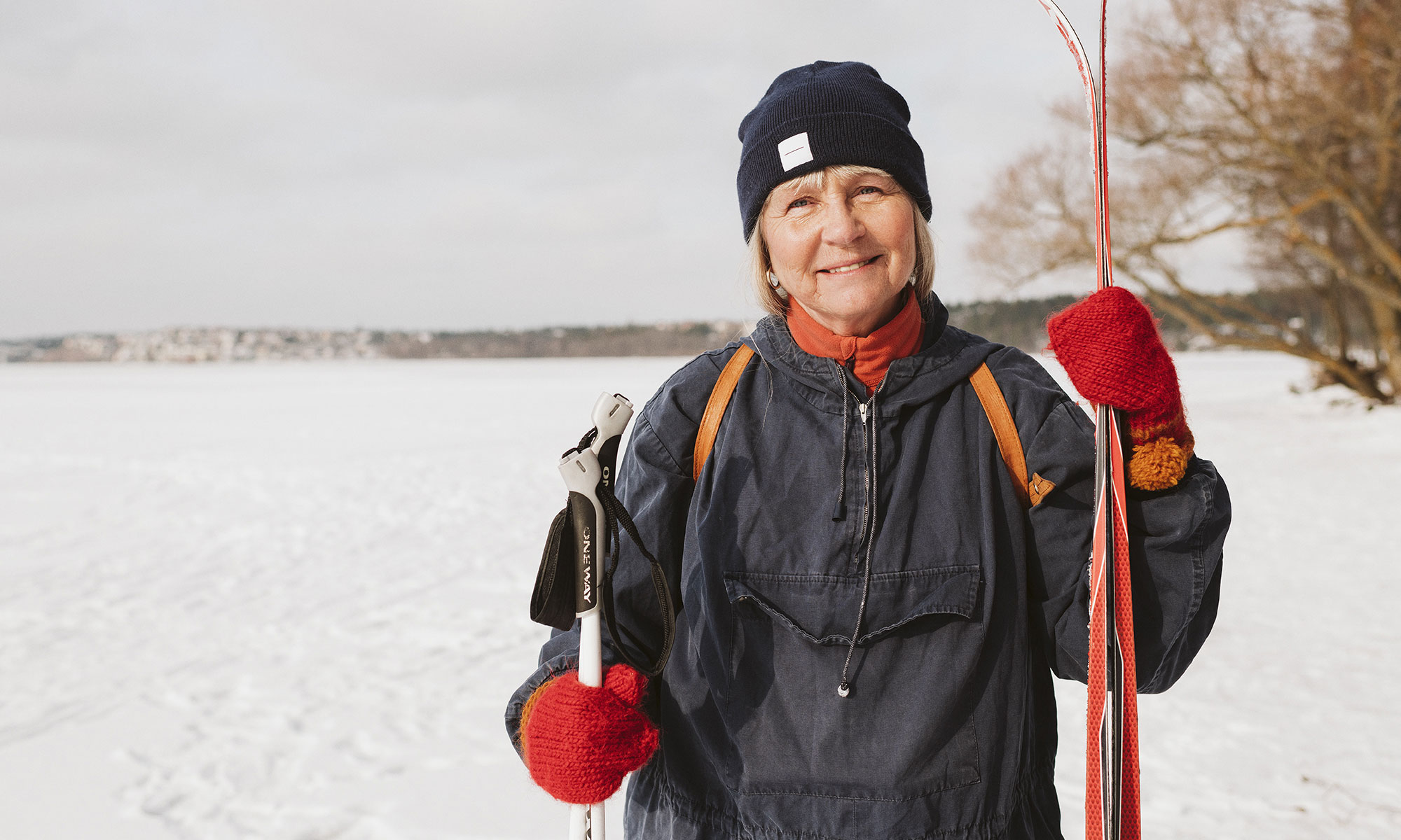 Woman holding skis.